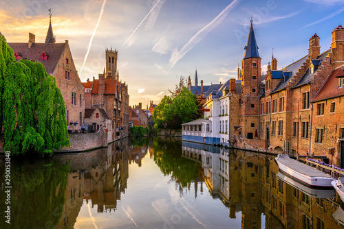 Wall Murals Old building Classic view of the historic city center of Bruges (Brugge), West Flanders province, Belgium. Sunset cityscape of Bruges. Canals of Brugge
