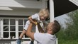 Father and little boy have fun. a man holds a child in his arms and raises up