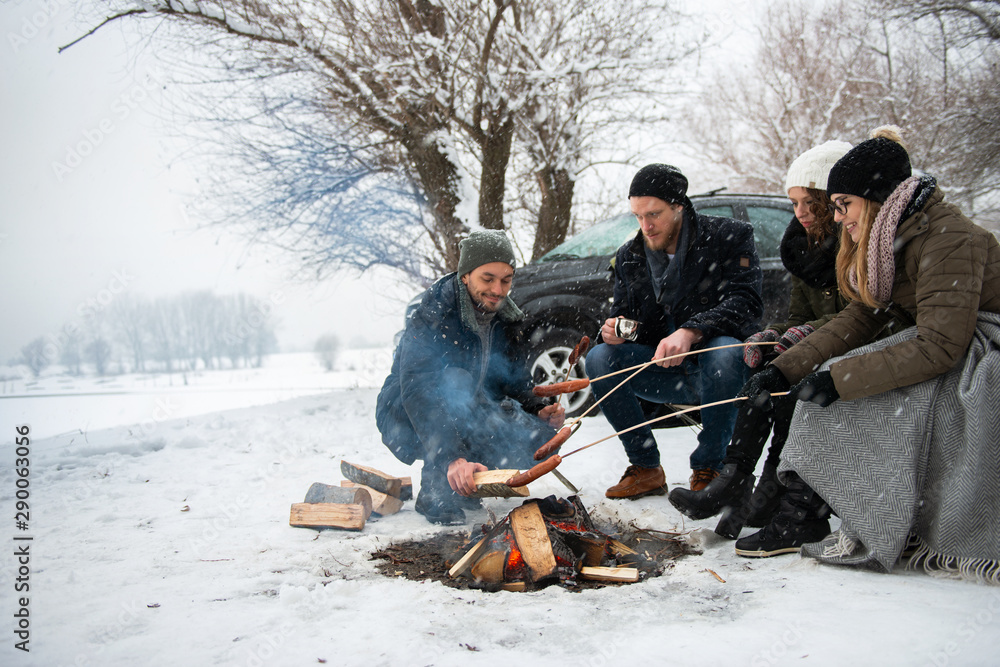 Fototapety, obrazy: Friends having barbecue on a snowy day
