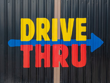 Colorful Drive Thru Sign In Red, Blue And Yellow On Metal Sheet Background