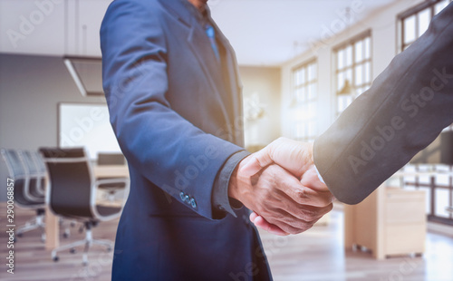 Business people shake hands in the office - Image Wallpaper Mural