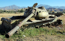 Bamyan (Bamiyan), Central Afghanistan. Destroyed Tanks In A Field - A Reminder Of The Afghanistan War. There Are Many Abandoned Armored Vehicles And Weapons From The Afghan War Near Bamyan (Bamiyan).
