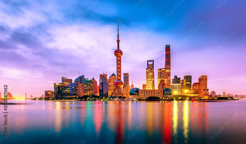 Fototapety, obrazy: Cityscape of Shanghai at twilight sunset. Panoramic view of Pudong business district skyline from the Bund.
