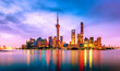 Cityscape of Shanghai at twilight sunset. Panoramic view of Pudong business district skyline from the Bund.