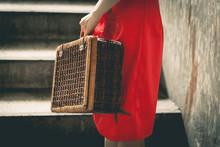Vintage Chinese Traveler Holding A Vintage Travel Luggage