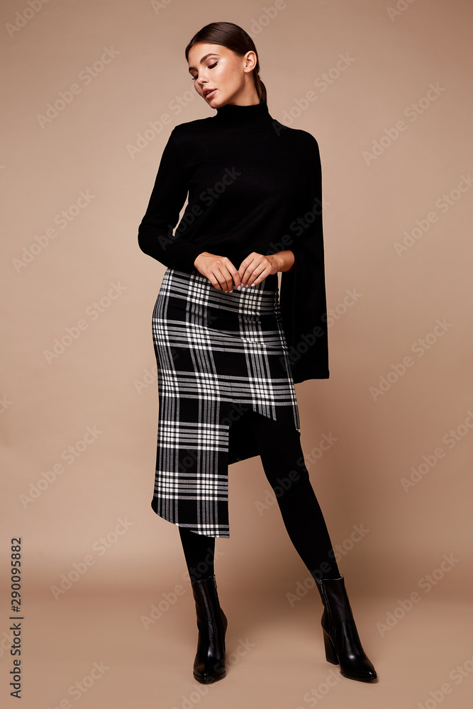 Fototapeta Sexy pretty fashion woman wear skirt sweater trend clothes collection catalogue long brunette hair party style model pose bright make-up beautiful face dress code office casual accessory shoes.