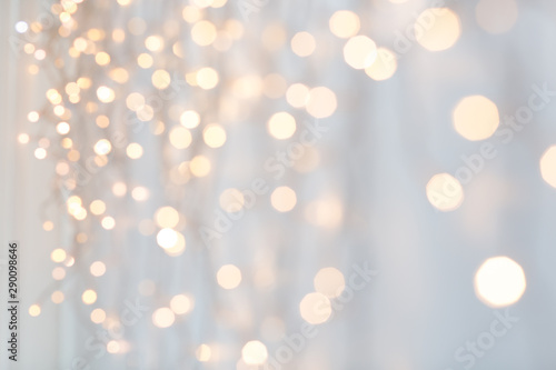 Fototapety, obrazy: holiday, illumination and decoration concept - bokeh of christmas garland lights over grey background