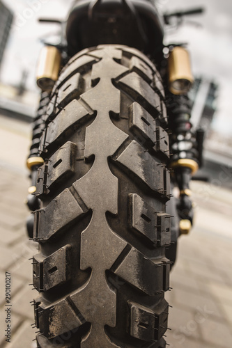 Fotomural  Rear view of motorcycle wheel with tire tread closeup