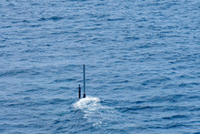 Real Periscope And Radio Transmission Mast Of The Attack Submarine  During The Submarine Sails In The Periscope Depth In The Sea