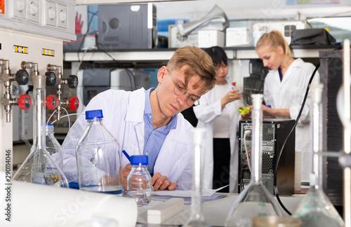 Stampa su Tela  Male scientist working at biochemical laboratory