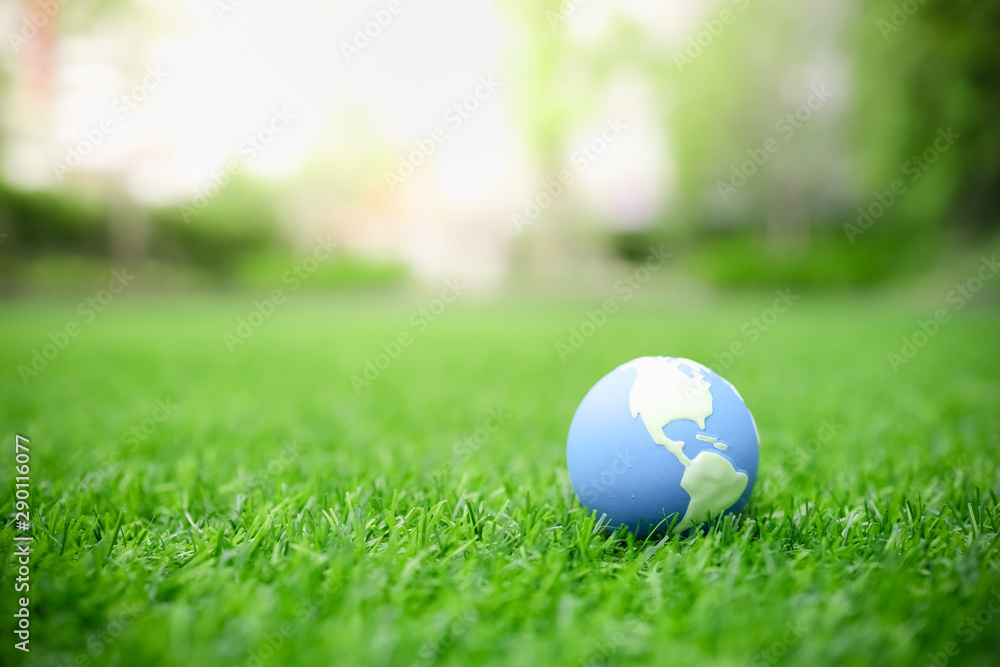 Fototapety, obrazy: Global Warming, Environment and Ecology Concept. Close up of mini world ball on green grass lawn with rain drop.