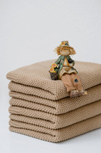A Stack Of Brown Cotton Plaids...