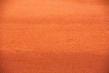 Red Clay Court Tennis Background Texture. Tennis Court Close-up Of Gravel Surface.