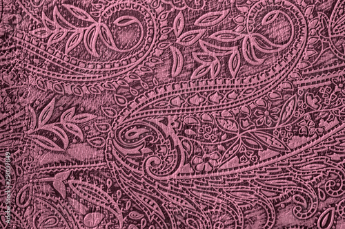 Fotografija  Texture of genuine leather close-up, burgundy purple color with embossed paisley