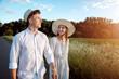 Loving couple having a walk through sunset summer countryside
