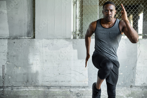 African american exercising in urban area on concrete surface, cardio, high endu Wallpaper Mural