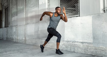 African American Male Athlete Sprinter, Running At A High Speed In Urban Concrete City Background With Copy Space