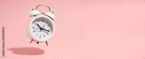 Fototapeta Pink Alarm clock on pastel pink background. obraz