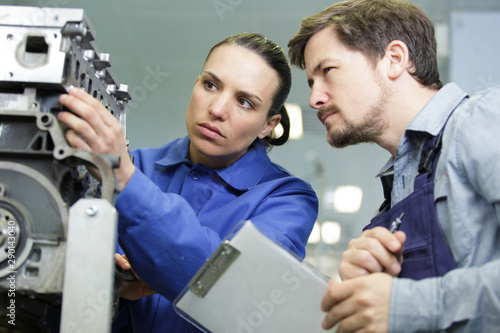 Fotomural couple of technicians checking an engine machine
