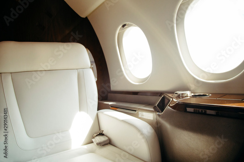Valokuvatapetti modern and comfortable interior of business jet aircraft with decor