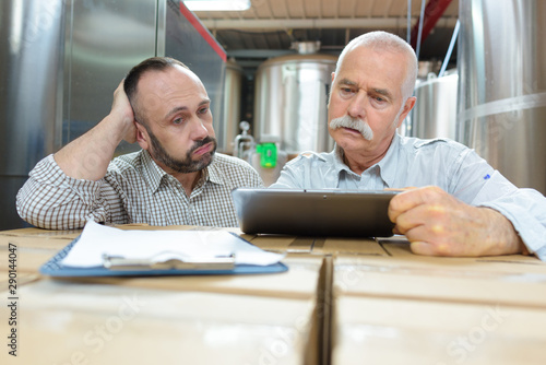 brewery businessmen working on tablet