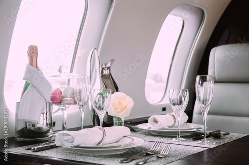 Obraz na płótnie modern and comfortable interior of business jet aircraft with decor