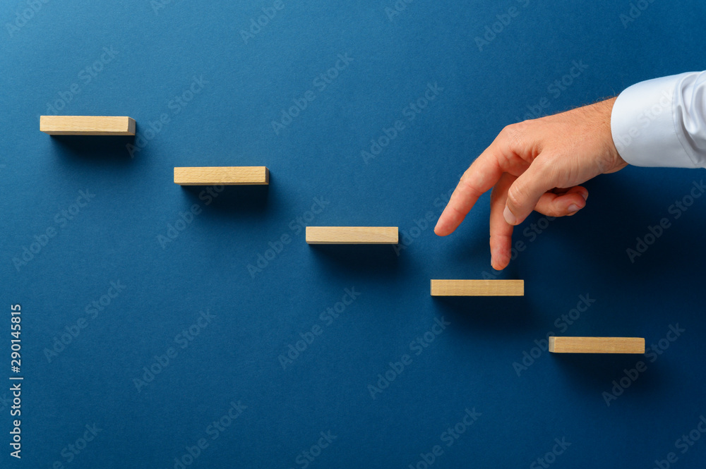 Fototapety, obrazy: Businessman walking his fingers up a stairway