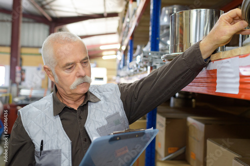 senior manager check stock in the warehouse