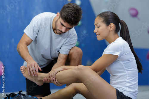 Foto op Plexiglas Hoogte schaal man putting ointment cream on bad injured ankle