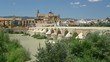 Panoramic sight in Cordoba, with the Roman Bridge and Mezquita on the Guadalquivir River. Andalusia, Spain.