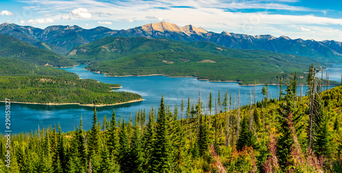 Photo Stands Green blue Hungry Horse Reservoir with the Great Northern Mountain Standing Tall