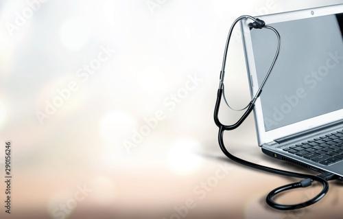 Fotografia  Laptop diagnosis with  stethoscope  on background