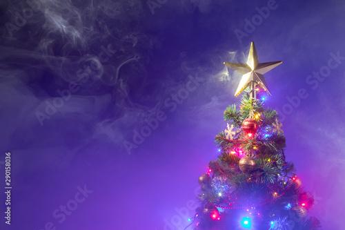 canvas print motiv - nikkytok : Christmas tree with festive lights, purple background with smoke