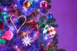 canvas print picture Christmas tree with decorations and purple illumination, close-up view