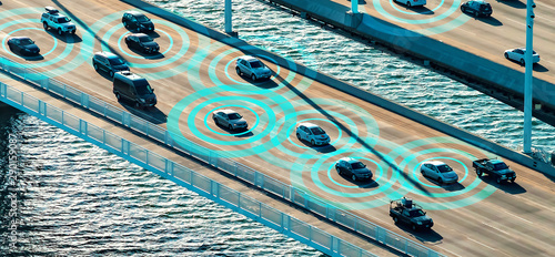 Photo  Autonomous vehicles driving and communicating on the highway