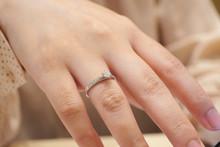 Close Up Diamond Ring On Woman Finger