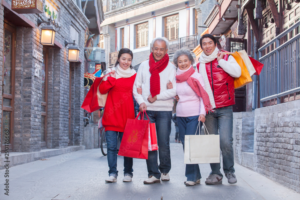 Fototapety, obrazy: Family shopping together dressed in holiday attire