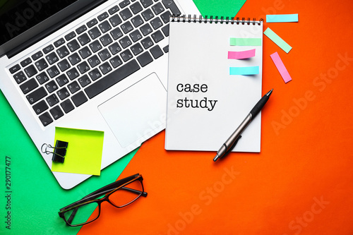 canvas print motiv - Pixel-Shot : Laptop and school stationery on color background, top view. Concept of study