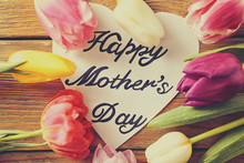 Flowers And Card With Words HAPPY MOTHER'S DAY On Wooden Background, Top View