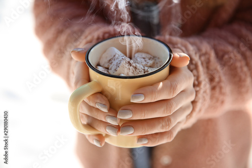 In de dag Chocolade Woman with cup of hot cacao and marshmallows outdoors, closeup