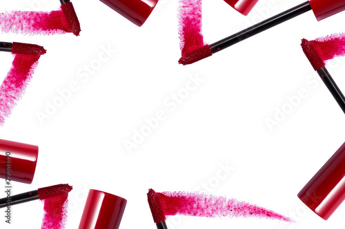 Fotografía  Red lip gloss brush and container around border with empty space