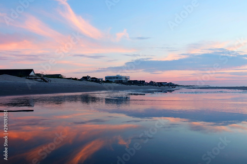 Rose clair / pale Early morning at the Atlantic beach.Marine background with beautiful colorful sky reflects in a shallow water during low tide before sunrise. Scenic seascape at the Pawleys Island, South Carolina,USA.