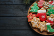 Tasty homemade Christmas cookies on dark blue wooden table, top view. Space for text