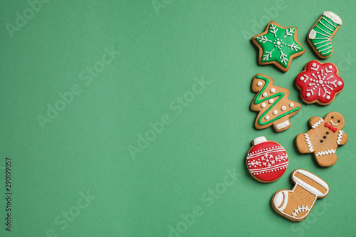 Fototapety, obrazy: Flat lay composition with tasty homemade Christmas cookies on green background, space for text