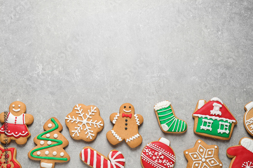 Flat lay composition with tasty homemade Christmas cookies on grey table, space for text