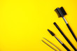 Leinwanddruck Bild - Set of professional eyebrow tools on yellow background, flat lay. Space for text