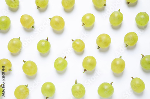Fotografiet  Fresh ripe juicy grapes on white background, top view