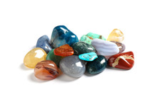 Pile Of Different Beautiful Gemstones On White Background