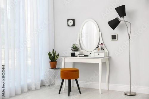 Dressing table with mirror in stylish room interior Fototapeta