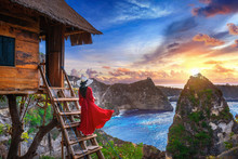 Young Girl On Steps Of House On Tree At Atuh Beach In Nusa Penida Island, Bali In Indonesia.